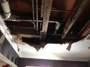 water leaking from pipes in ceiling